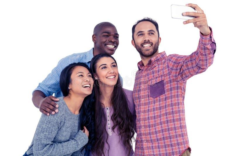 Multi-etnische vrienden die selfie nemen stock afbeeldingen