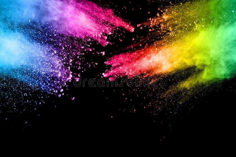 Multi explosão abstrata do pó da cor no fundo preto imagem de stock