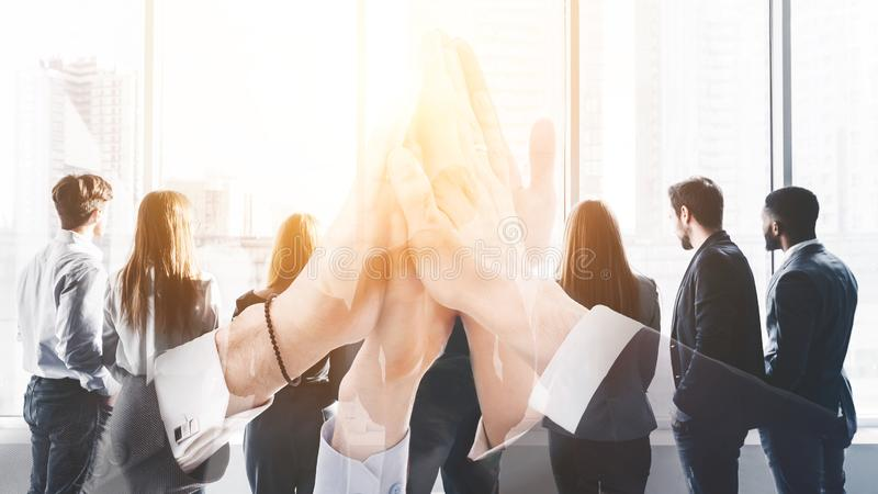 Multi exposure of business team high five with group of colleagues stock images