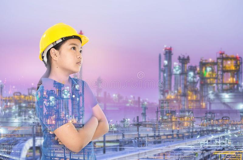 Multi exposure of young lady with refinery industrial plant stock photography