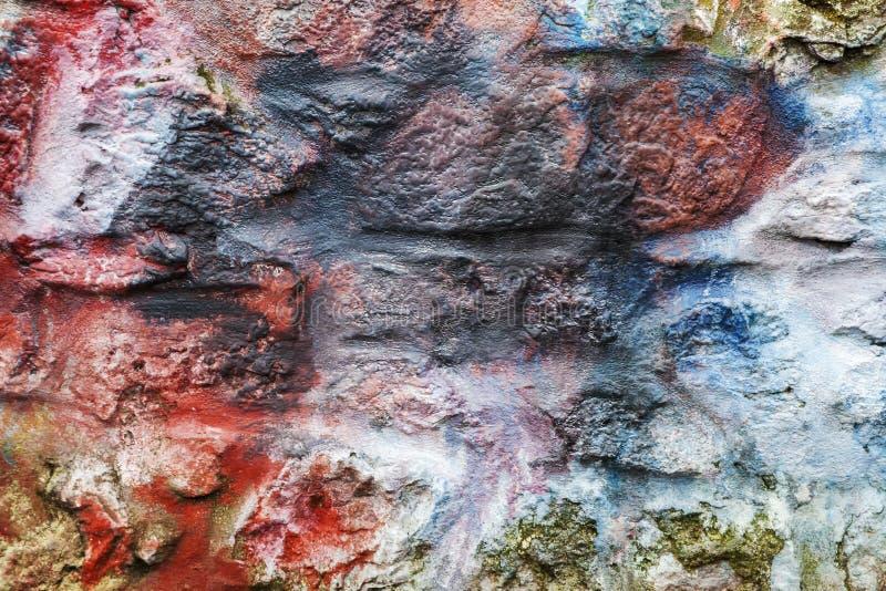 Multi fondo di pietra dipinto colorato del muro di mattoni immagine stock libera da diritti