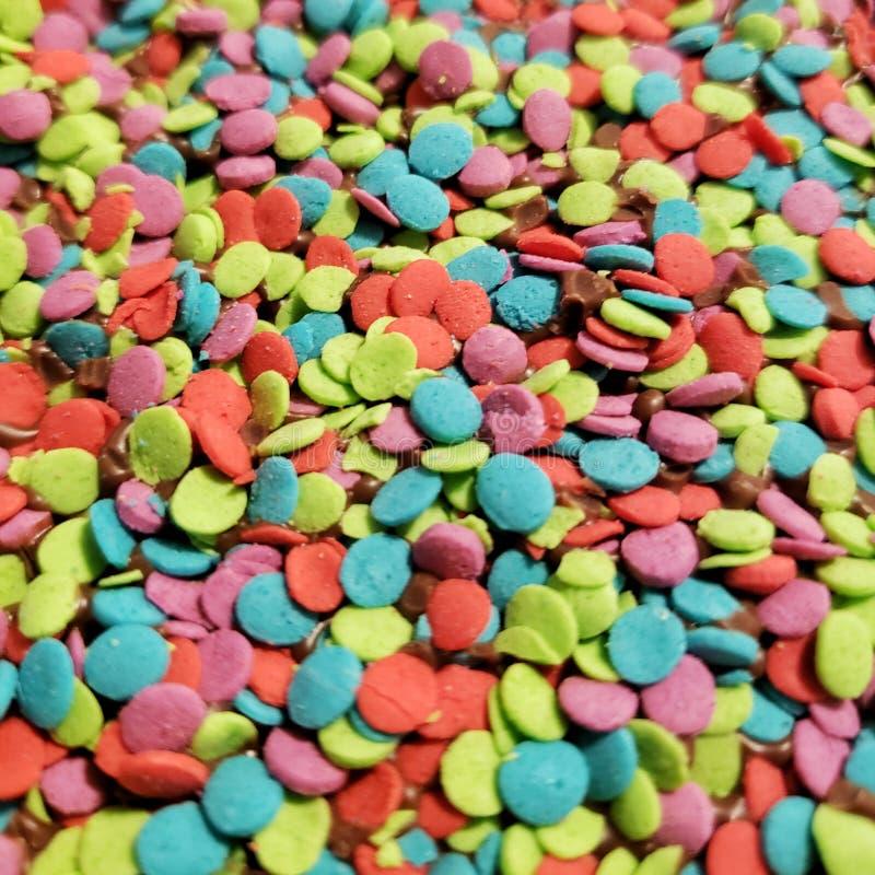 Multi gekleurd suikergoedbovenste laagje in close-up stock foto's
