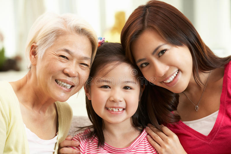 Multi Genenration Chinese Family Relaxing At Home Royalty Free Stock Images