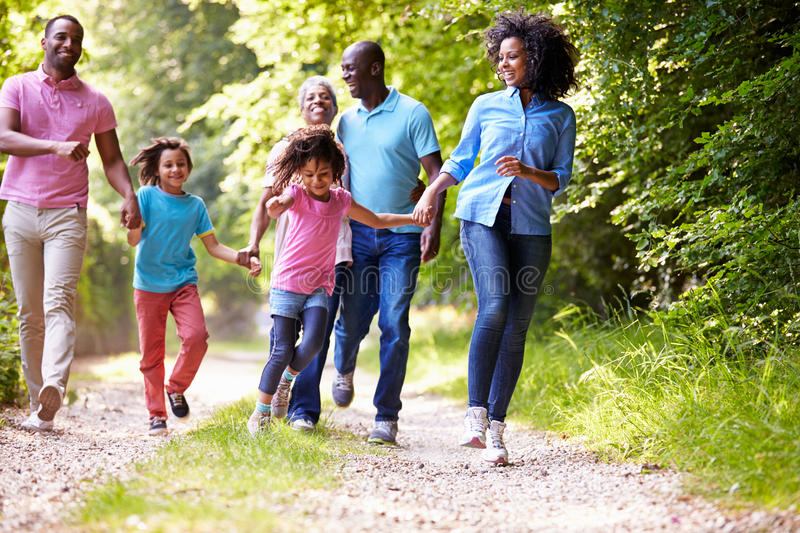 Multi Generation African American Family On Country Walk. Having Fun Whilst Holding Hands royalty free stock photos