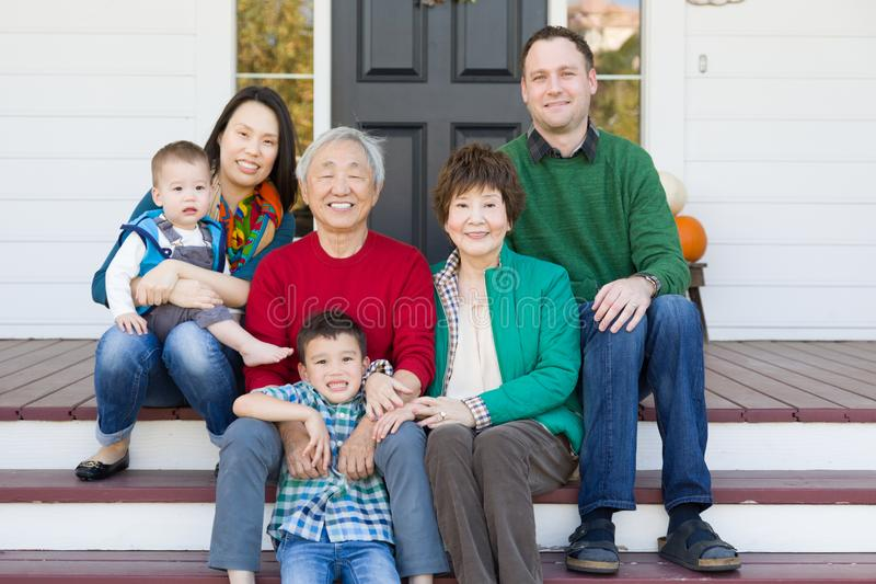Multi-generation Chinese and Caucasian Family Portrait royalty free stock photo