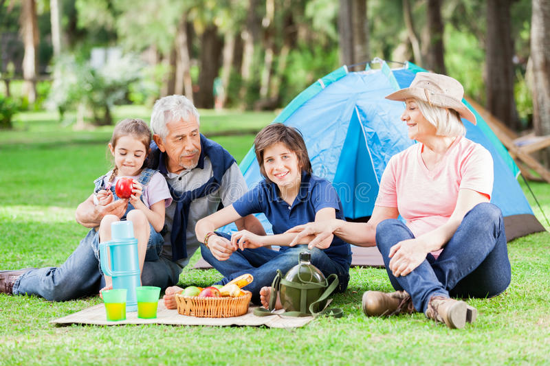 Multi Generation Family Camping In Park stock images
