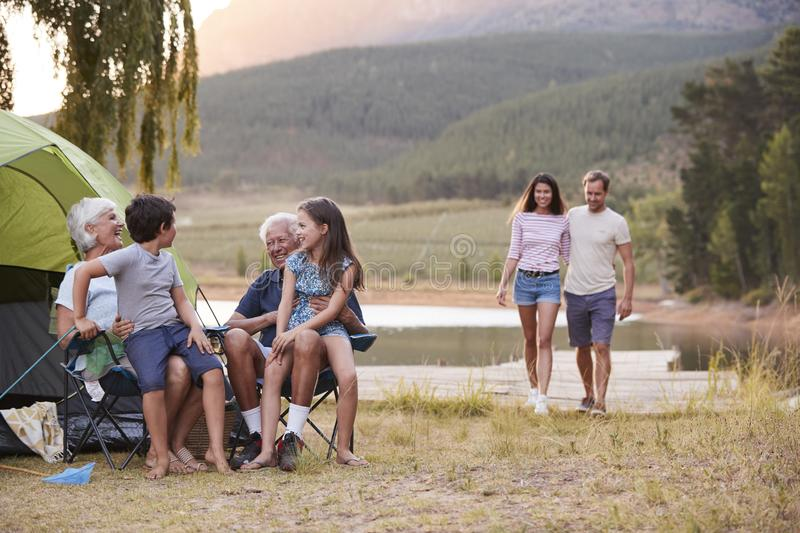 Multi Generation Family On Camping Trip By Lake Together stock photo