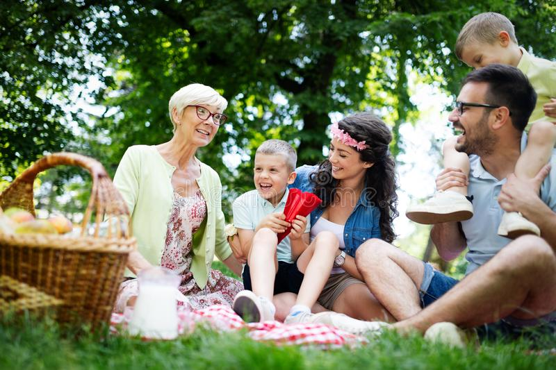 Multi generation family enjoying picnic in a park royalty free stock images