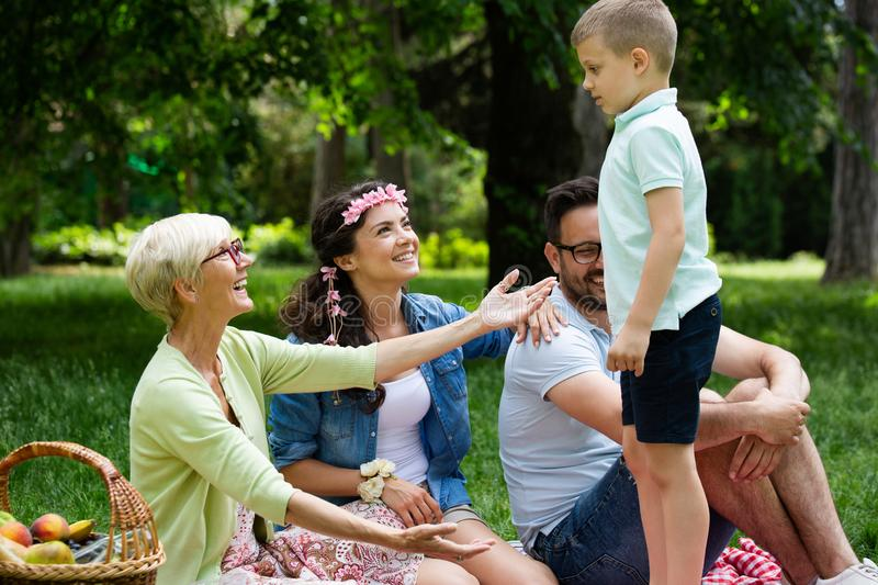 Multi generation family enjoying picnic in a park royalty free stock photography