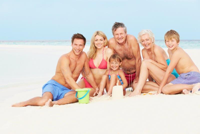 Multi Generation Family Having Fun On Beach Holiday. Smiling stock image