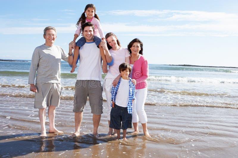 Multi Generation Family Having Fun On Beach Holiday. Smiling To Camera stock image