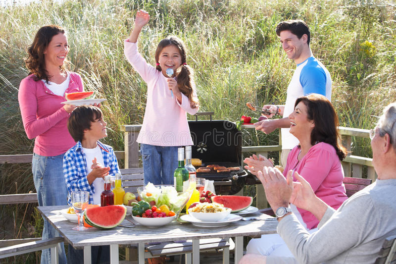 Multi Generation Family Having Outdoor Barbeque stock photo