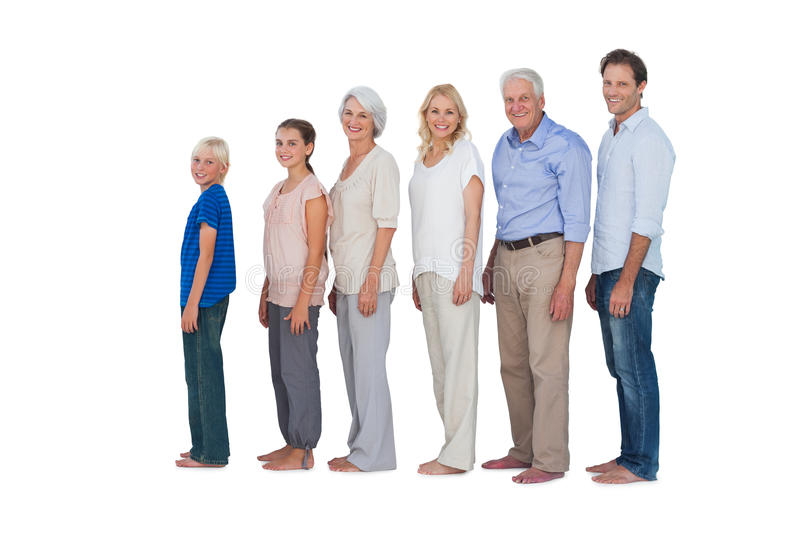 Multi-generation family posing together and looking at camera stock photography