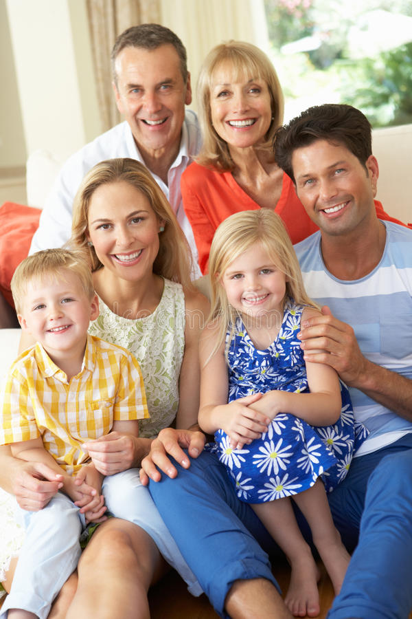 Download Multi Generation Family Relaxing On Sofa At Home Stock Photo - Image: 26615044