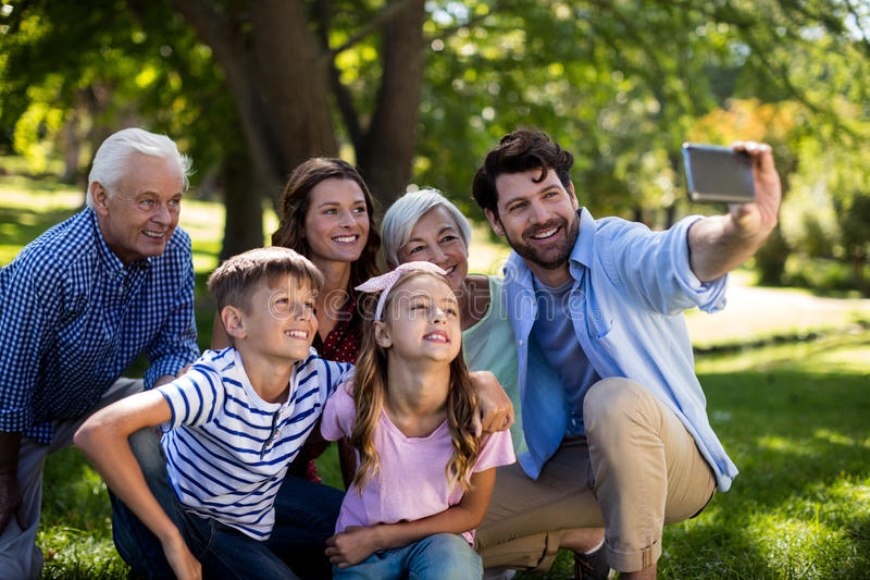 Multi generation family taking a selfie on mobile phone stock images