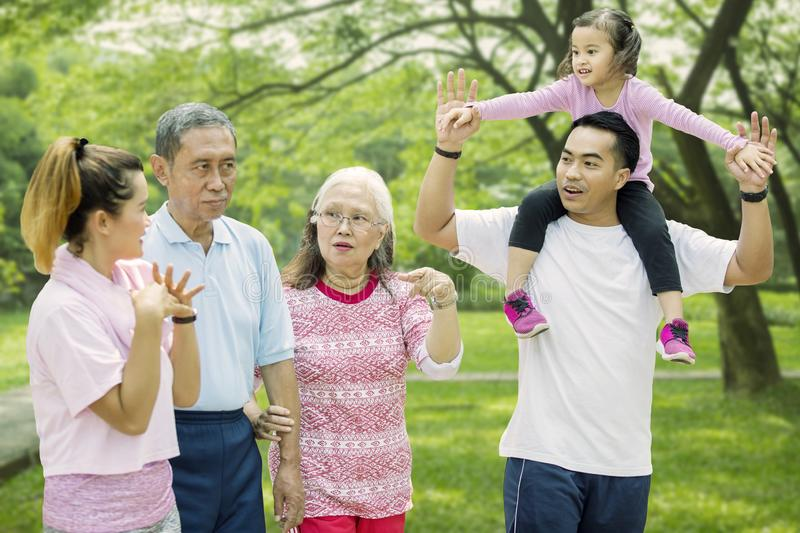 Multi generation family walks together in the park stock photos