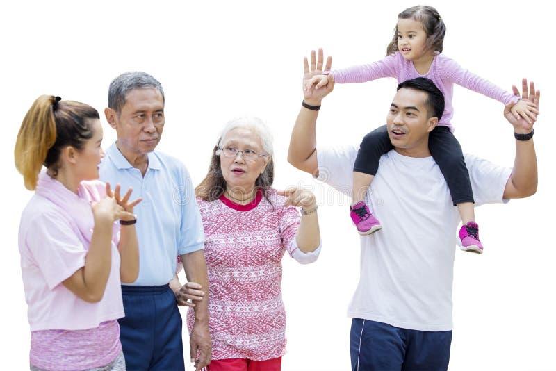 Multi generation family walks together on studio stock images