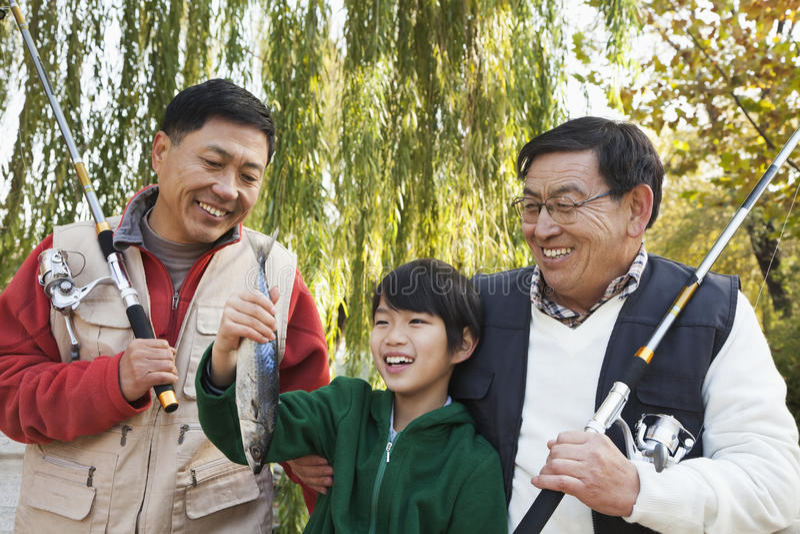 Multi-generational men fishing portrait royalty free stock photography