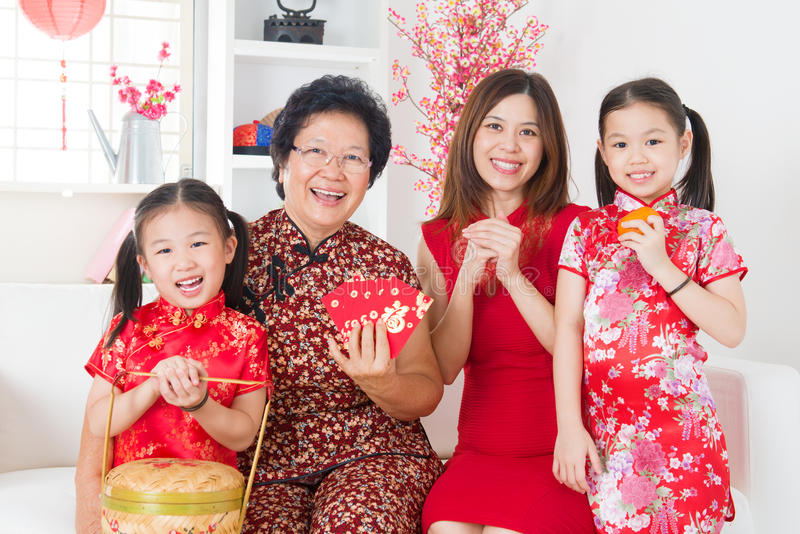 Multi generations Asian family celebrate Chinese new year. At home stock images