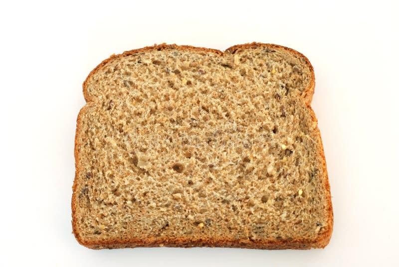 Multi grain whole bread slice. High fiber multi grain whole bread slice isolated on white royalty free stock images