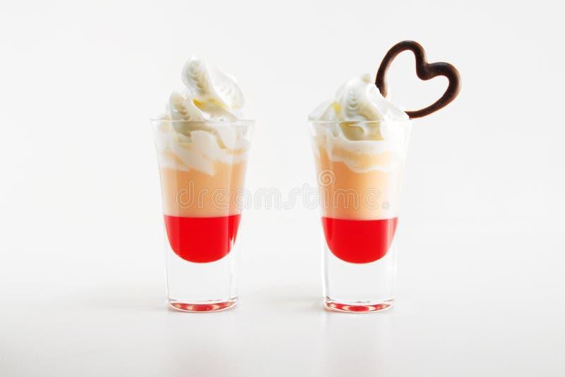 Multi-layered cocktail shot, close-up. Saint valentine`s day. stock photo