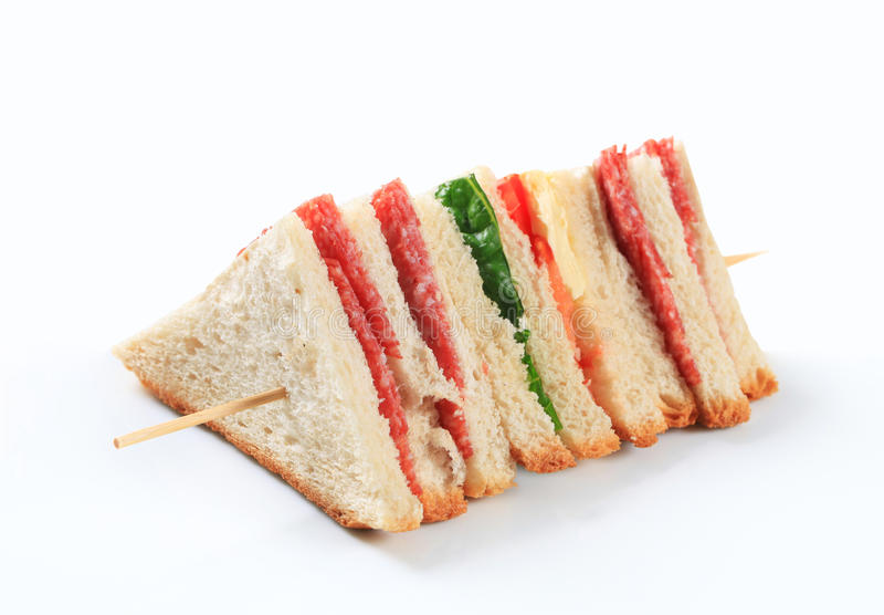 Multi-layered salami sandwich. Multi-layered sandwich with thin sliced salami royalty free stock photos