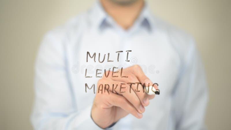 Multi Level Marketing, Man writing on transparent screen stock photo