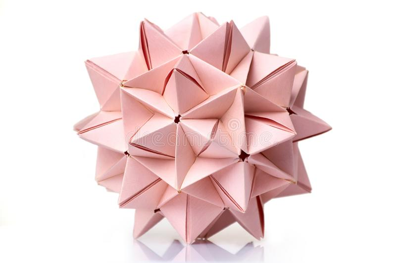 Multi piece spiky origami ball. On white background. Complex geometry and advanced skills of folding paper stock images