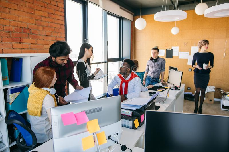 Multi racial business people are working out startup project royalty free stock photo