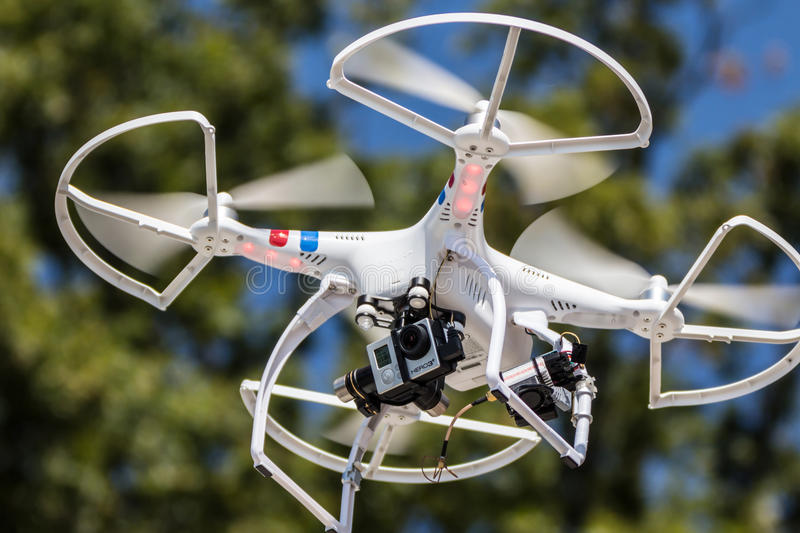 Multi rotor drone. A small drone hovering with camera attached stock photos