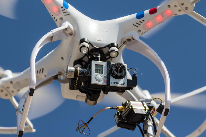 Multi rotor drone. A small drone hovering with camera attached royalty free stock photo