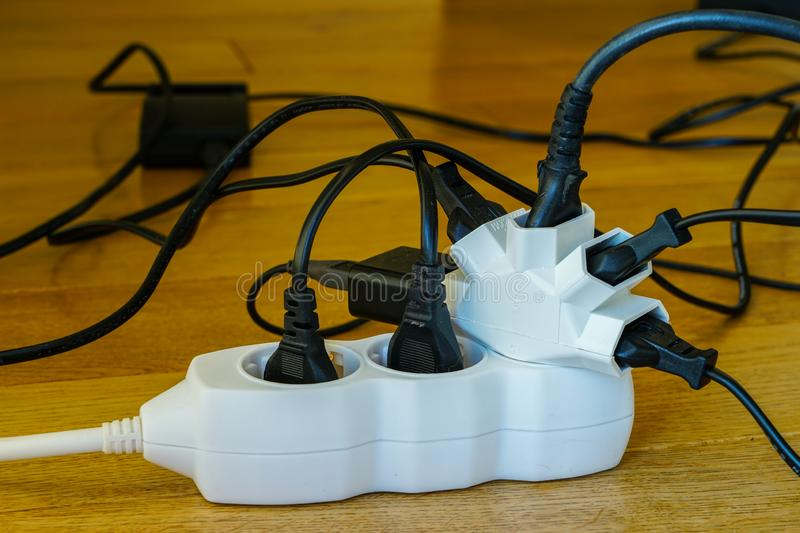 Multi socket with connected power Strip with a bunch of plugs royalty free stock photo