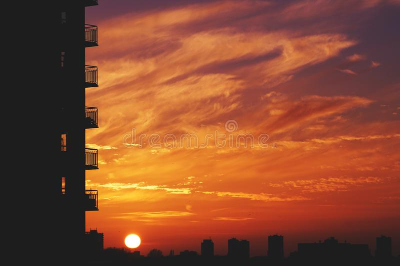 Multi storey apartments at sunset royalty free stock photography