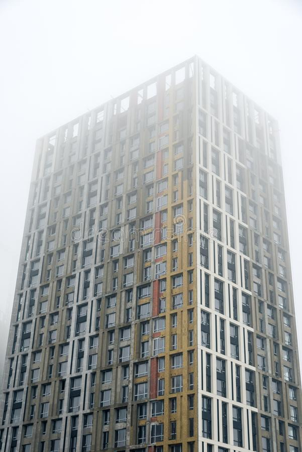 Multi-storey house in the fog. Horizontal frame stock photo