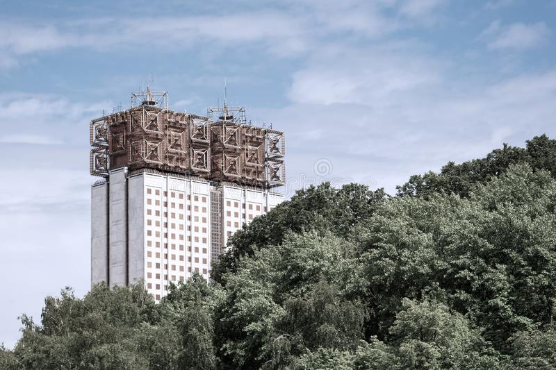Multi-storey house of unusual design against the sky and the forest.  royalty free stock photos