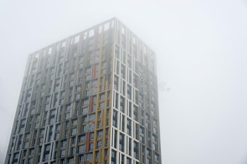 Multi-storey new house in the fog. Horizontal frame stock images