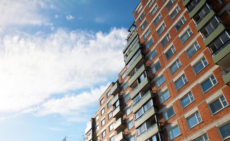 Multi-storey residential building against the blue sky.  royalty free stock photography