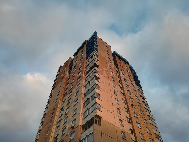 Multi-storey residential building in the morning at dawn.  stock photos