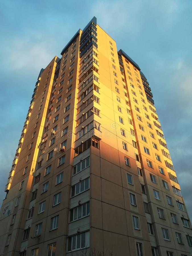 Multi-storey residential building in the morning at dawn.  stock photo
