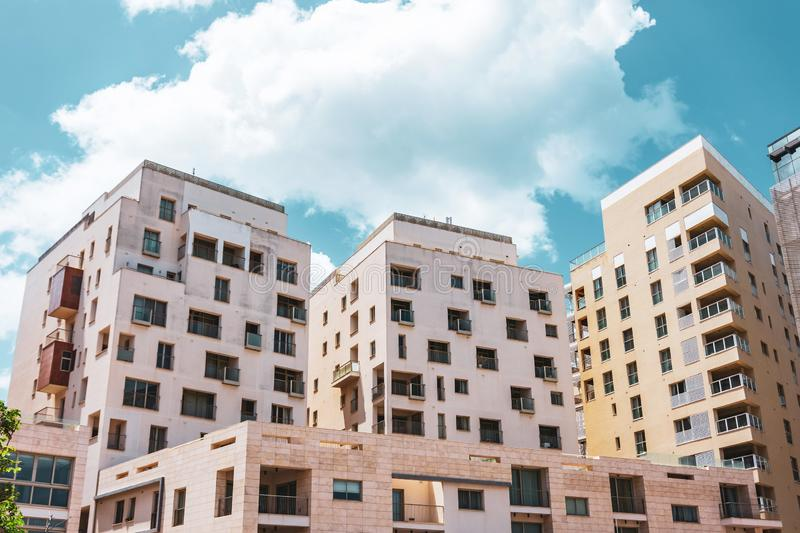 Multi-storey residential buildings and light stone in town city.  stock photo
