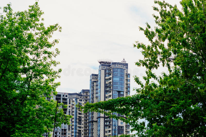 Multi-storey residential buildings view from the park.  royalty free stock photo
