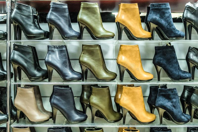 Multi-storey rows of womens off-season boots stock image