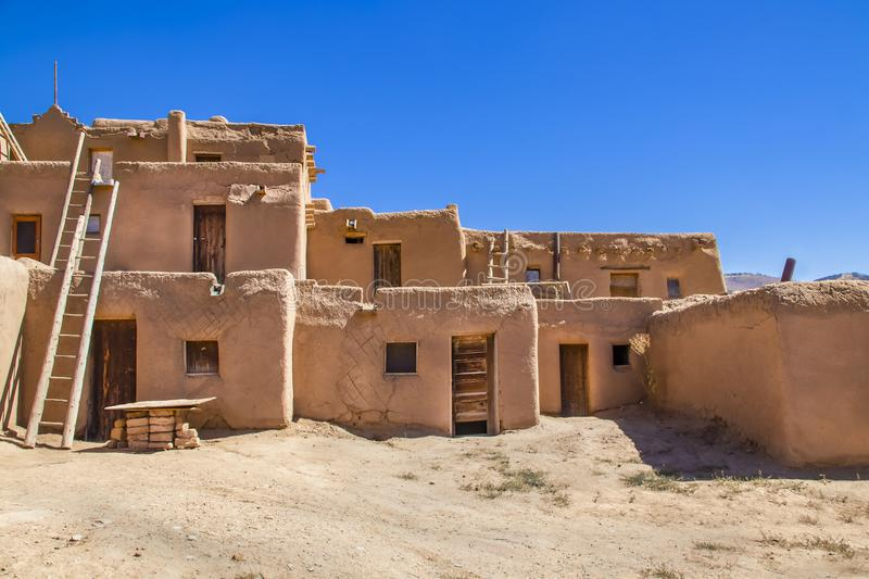 Multi-story adobe buildings from Taos Pueblo in New Mexico where Indigenous people are still living after over a thousand years royalty free stock photography