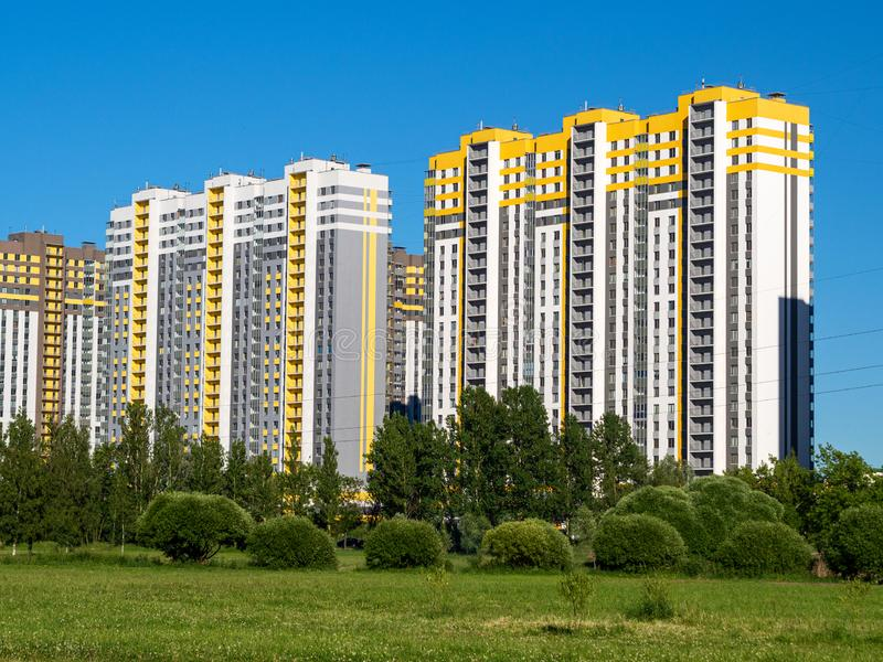 Multi-story building on a background of blue sky stock photo