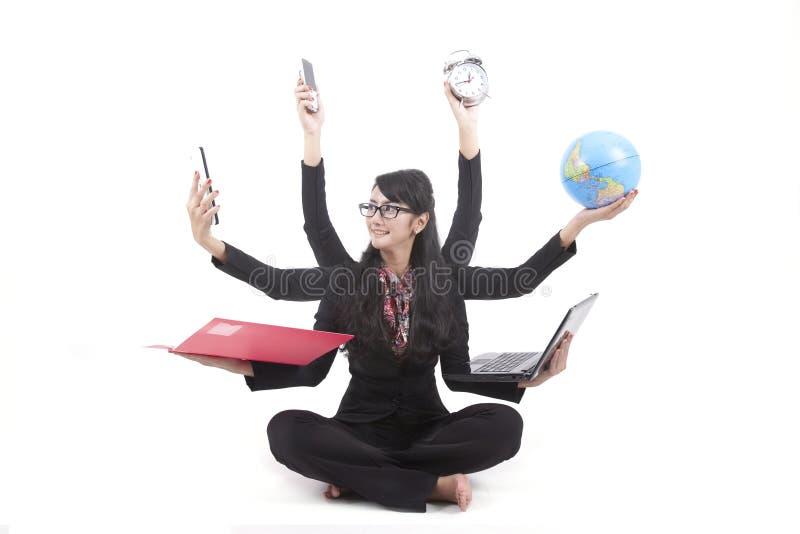 Multi-tasking Business Woman isolated on white stock image