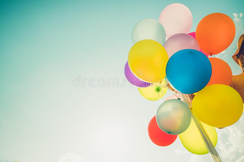 Multicolor balloons lor balloons done with a retro instagram filter effect, concept of happy birth day in summer and wedding honey. Multicolor balloons done with stock images