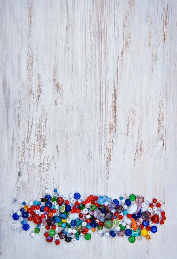 Multicolor beads on wooden background royalty free stock image