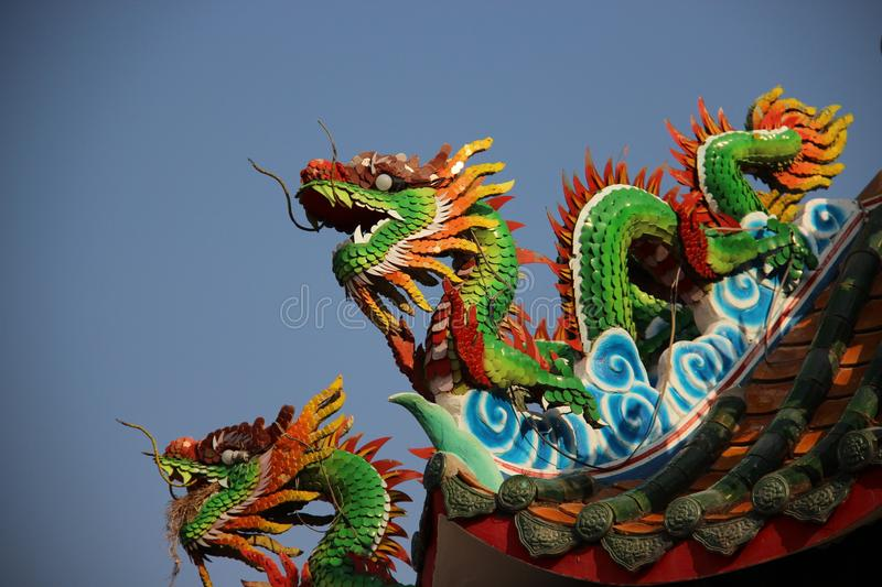 Multicolor Ceramic Dragons With Blue Sky. Still life Moses Dragons colorful fantasy animals decoration on shrine roof in Khonkaen Thailand stock photos