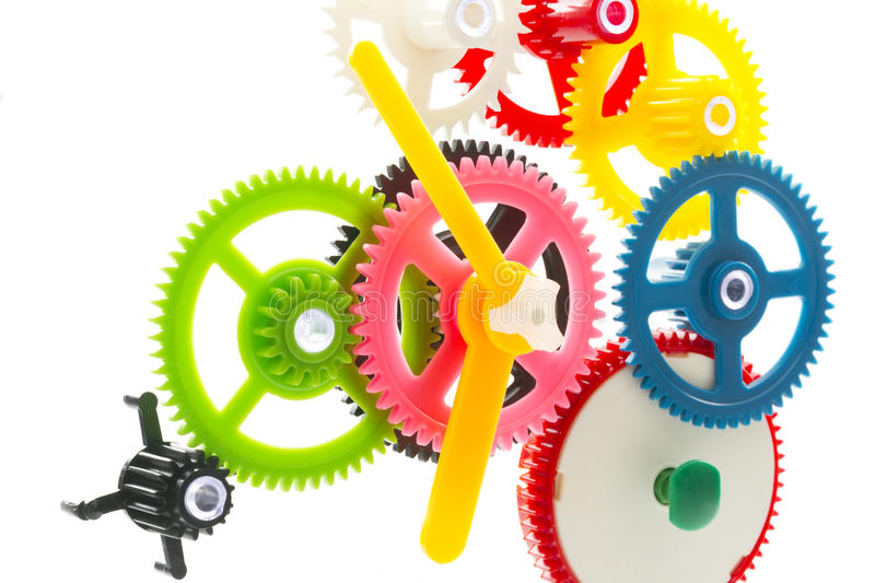 Multicolor clockwork. Group multicolor clockwork cogs mechanism isolated on white royalty free stock photos