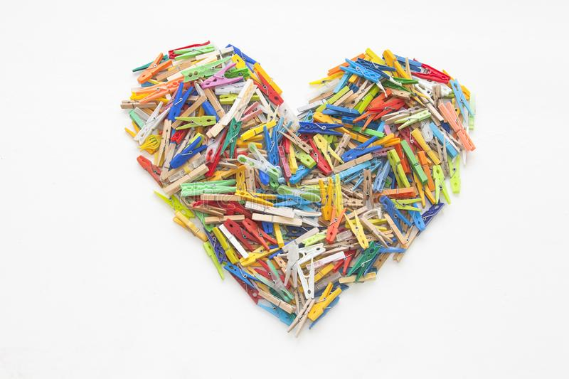 Multicolor clothespins - heartshaped obrazy stock